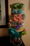 Finished headband holder, serving its purpose of taming frilly bows.