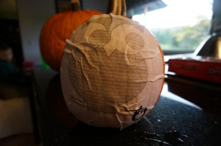 Smooth the design onto the pumpkin.