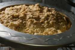 A pie crust shield keeps the crust from burning during the long baking time.