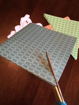 Cutting diagonally across folded paper
