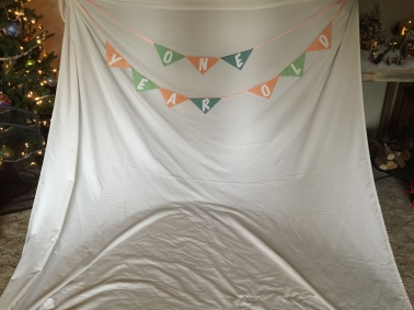 Birthday banner on a plain white sheet.