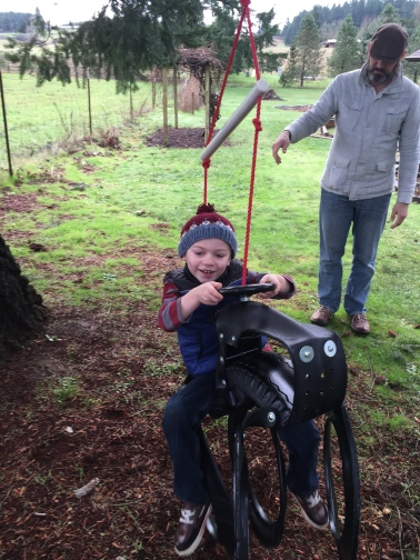 Tractor-shaped tire swing: Best. Gift. Ever.
