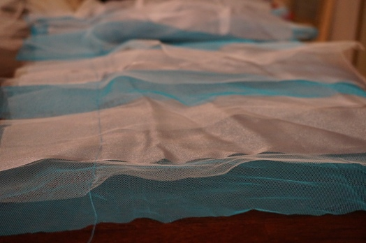 Fabric laid out in alternating strips, and basted.