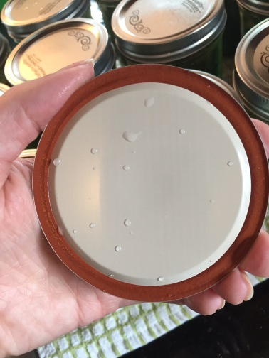The rubber seal is intact, but there's a big dent across the lid. Throw it out!