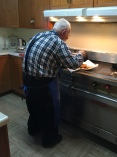 My grandpa making his famous fish fry.