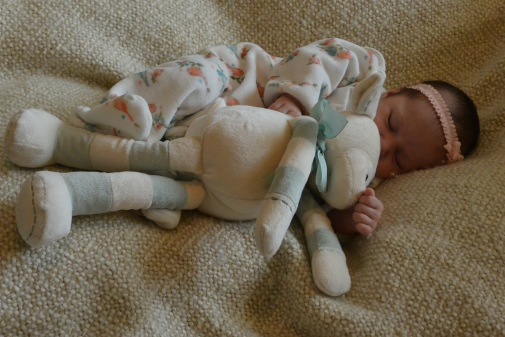 Sound asleep with Lambie, at one month old.